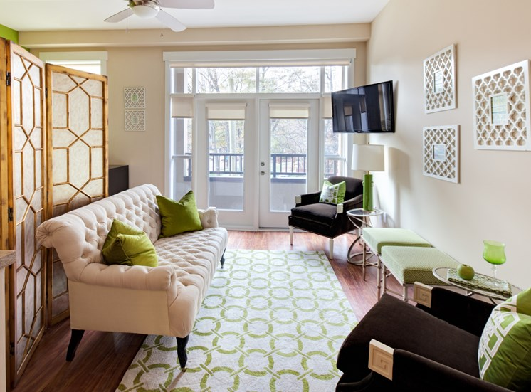 Well-lit room living rooms with natural light at St. Mary's Square Apartments, North Carolina, 27605
