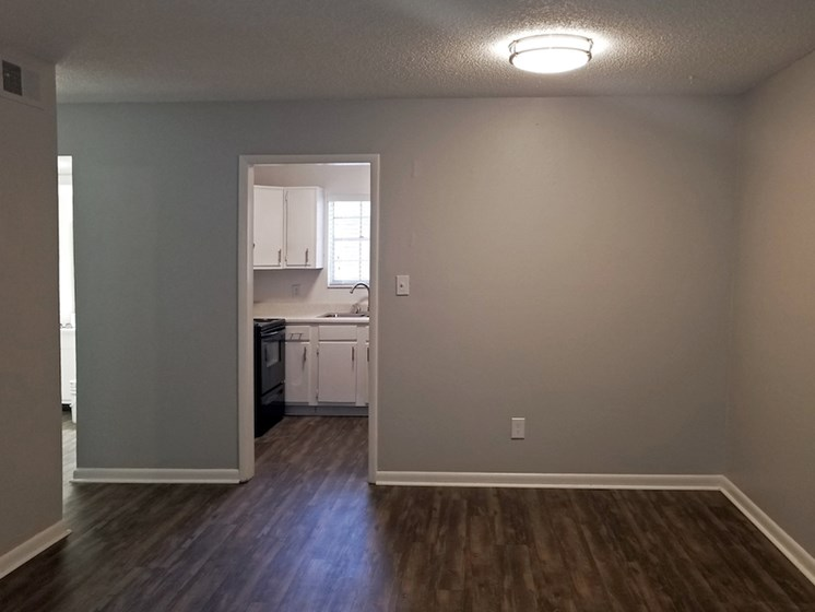 updated living room with hardwood styled flooring at Heritage Park Apartments in Tallahassee, FL 32304