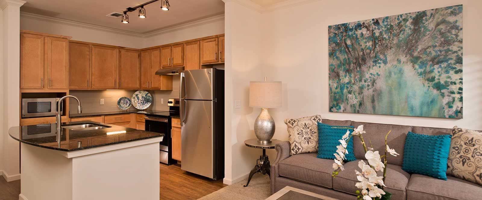 Fully-applianced kitchen with vinyl plank floors at Diamond Oaks Village, Florida, 34134