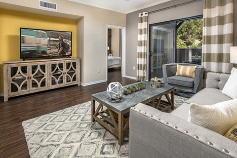 Living area with TV and sliding glass doors to patio