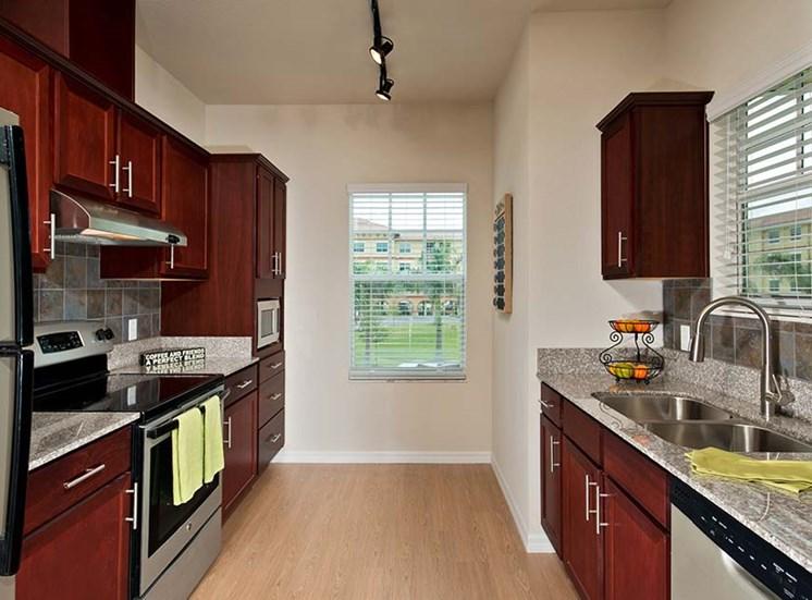 Fully-applianced kitchen at Sandalwood Village, Naples, Florida