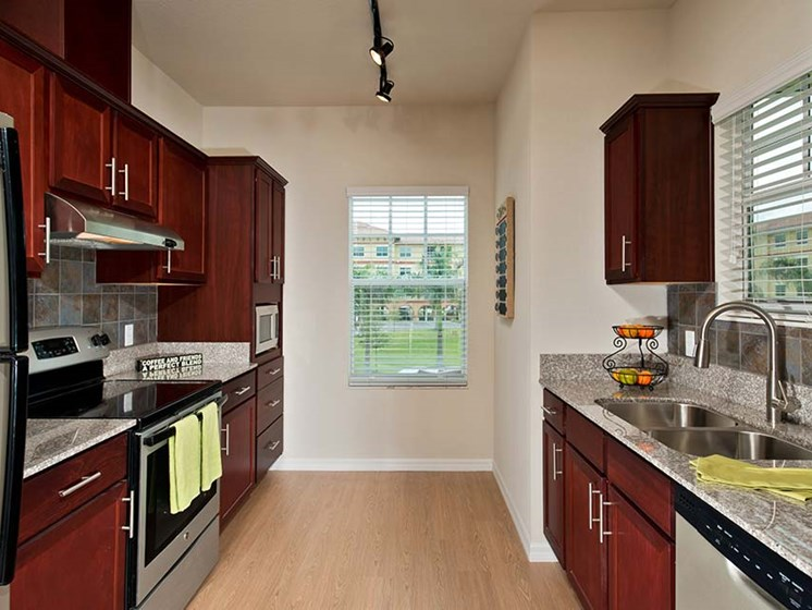 Fully-applianced kitchen at Sandalwood Village, Naples, Florida
