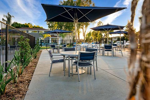 Table and chairs by pool |Nola624 Apts in West Covina