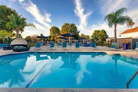 Pool with lounge chairs |Nola624 Apts in West Covina