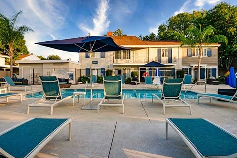 Lounge chairs by pool |Nola624 Apts in West Covina