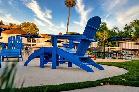 Lounge chairs by grass |Nola624 Apts in West Covina