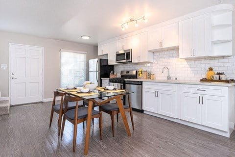 Apartments in West Covina CA-Nola624 Apartments Kitchen with Stainless Steel Appliances and Dining Table