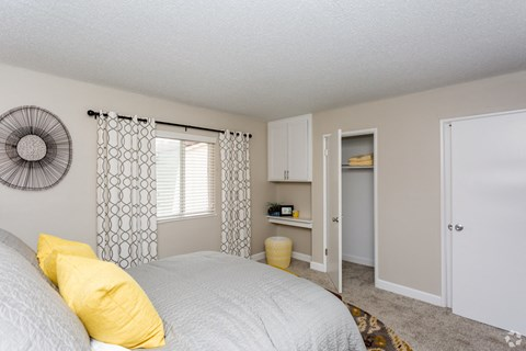 One Bedroom Apartments in West Covina, CA - Nola624 Apartments Bedroom with Window, Carpet Flooring, and Spacious Closet