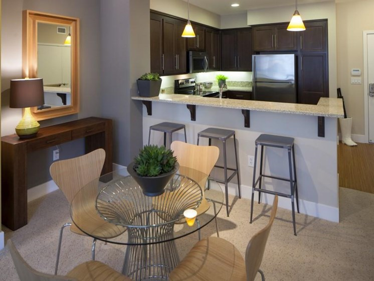 Model apartment home dining room and kitchen