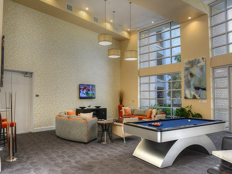 Resident lounge with wall tv, billiard and seating area