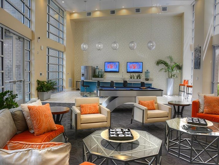 Resident lounge and kitchen with flat screen tvs