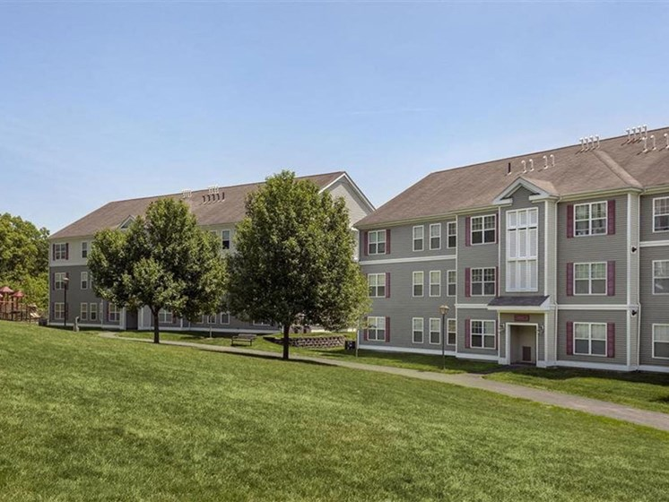 Large Lawn and Walkway at Franklin Commons Apartments in Franklin, MA