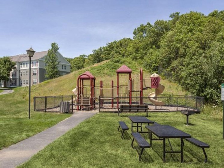 On-Site Playground With Benches at Franklin Commons Apartments in Franklin, MA