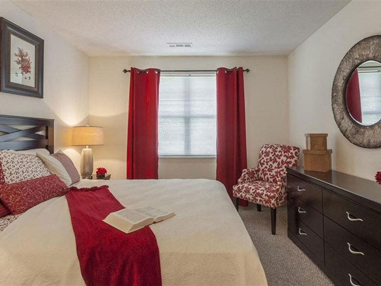 Master Bedroom With Stylish Decor at Quail Run Apartments in Stoughton, MA