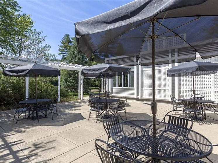 Outdoor Patio With Seating at Quail Run Apartments in Stoughton, MA