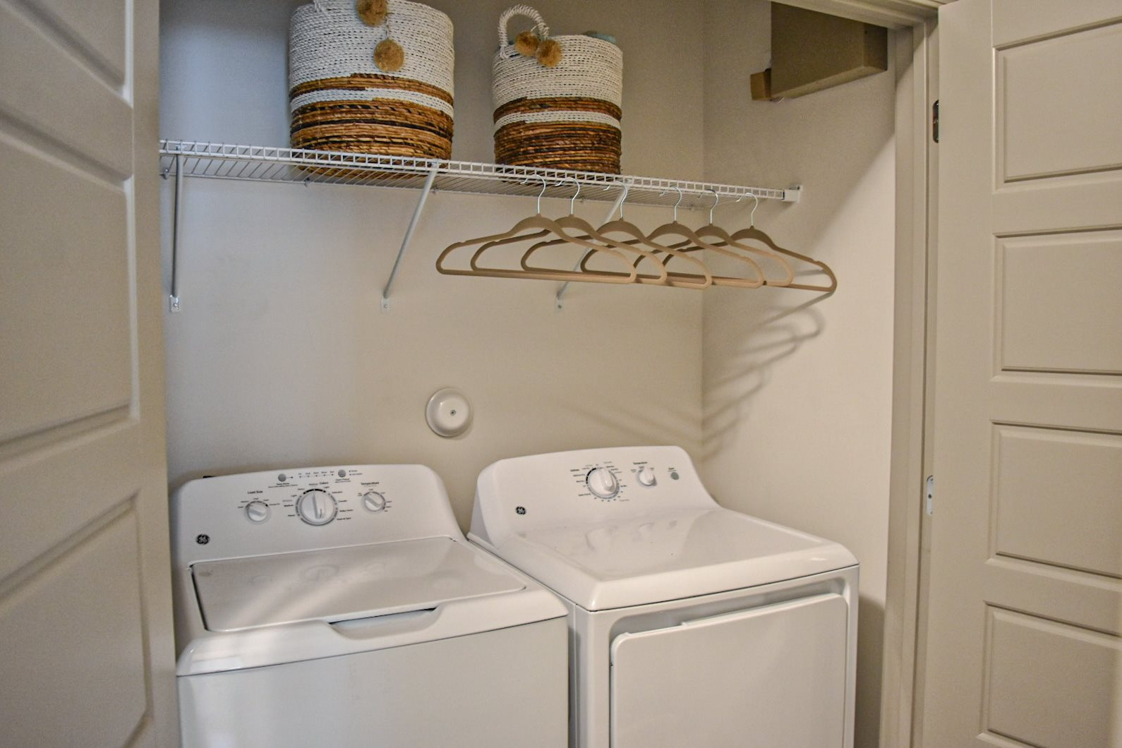 Full-sized washer dryer closet in apartment Hawthorne at Smith Creek