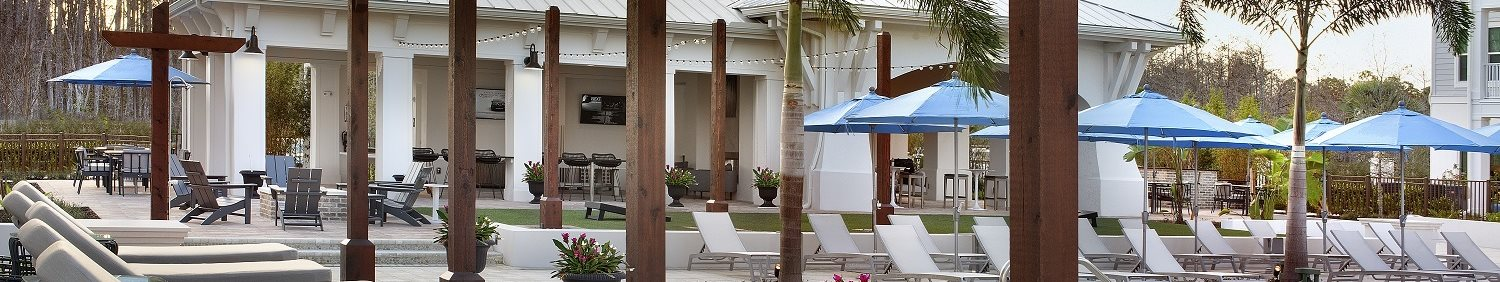 Relaxing Lounge Cabanas by the Refreshing Swimming Pool at The Edison Apartments, Fort Myers, FL 33905