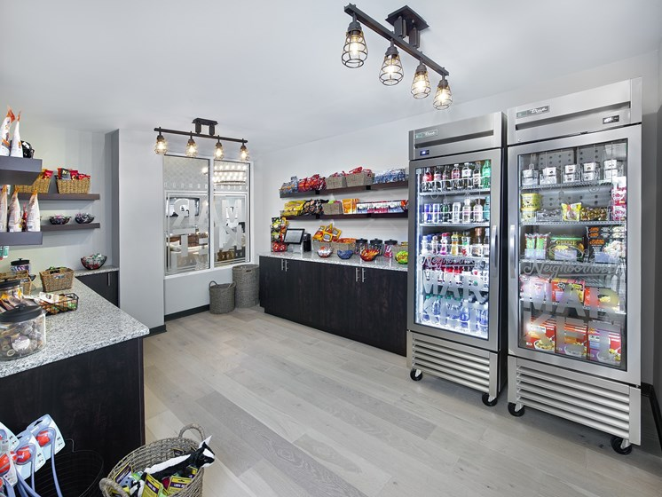 Our Clubhouse includes a Community Market with Stocked Shelfs of Snacks and Cold Drinks at The Edison Apartments, Fort Myers, FL 33905