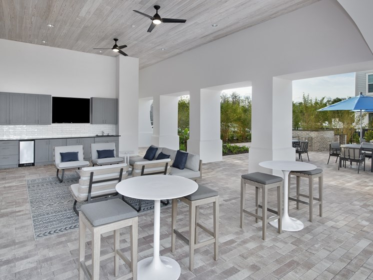 Two Outdoor Pavilions with TV's and Lawn Games at The Edison Apartments, Fort Myers, FL 33905