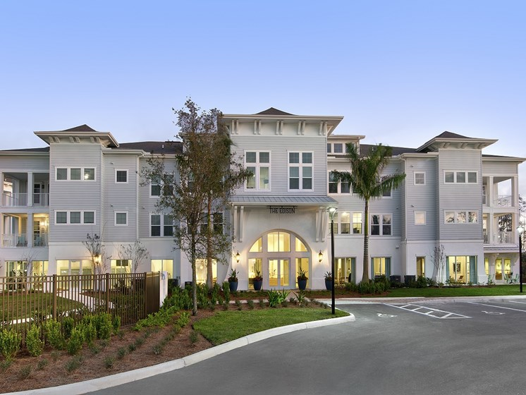 Pristine Landscaping, Bright Exterior and Inviting Amenities Welcome You at The Edison Apartments in Fort Myers, FL 33905