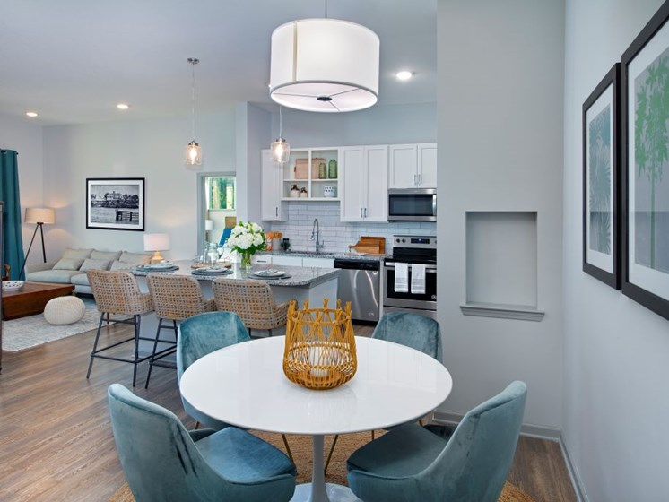 Bright White Kitchens with Side by Side Fridge, Granite Countertop, Designer Ceramic Tile Backsplash and Glass Top Ranges at The Edison Apartments, Fort Myers, FL 33905