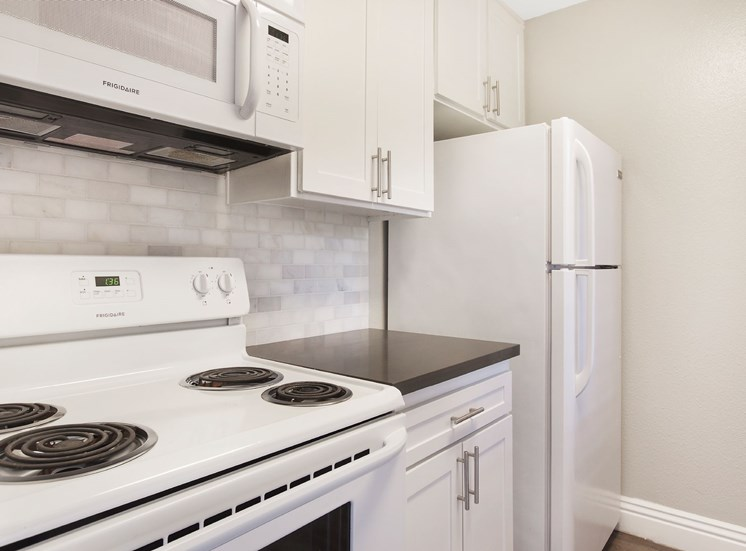 All Electric Kitchen In White at Pacific Trails Luxury Apartment Homes, California, 91722