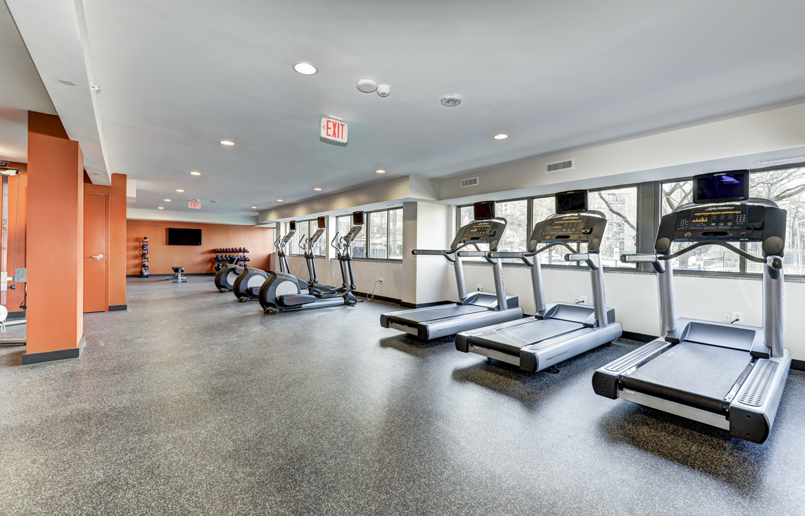 Fitness Center With Cardio Equipment at The Mark Apartments, Alexandria, Virginia