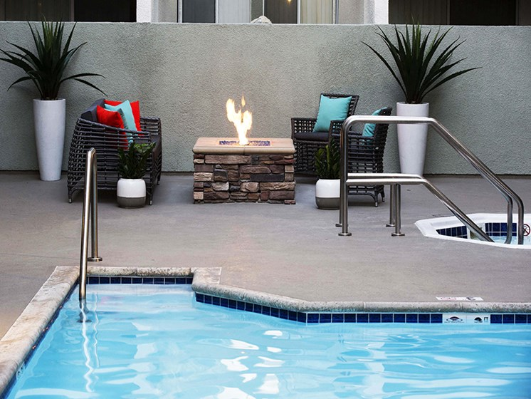 Exterior pool with lounge chairs & fire pit