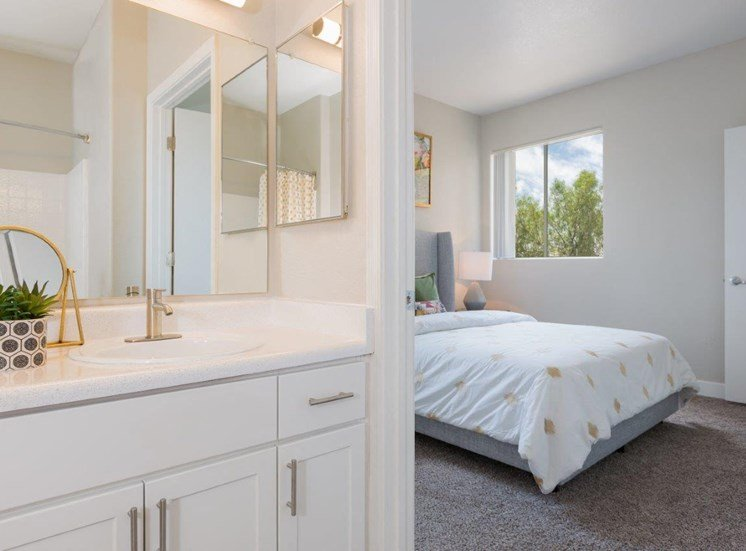 Model apartment home bathroom and partial bedroom