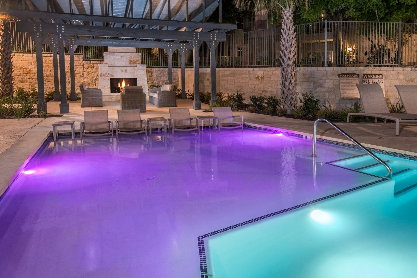 sparkling swimming pool at night in san antonio apartments