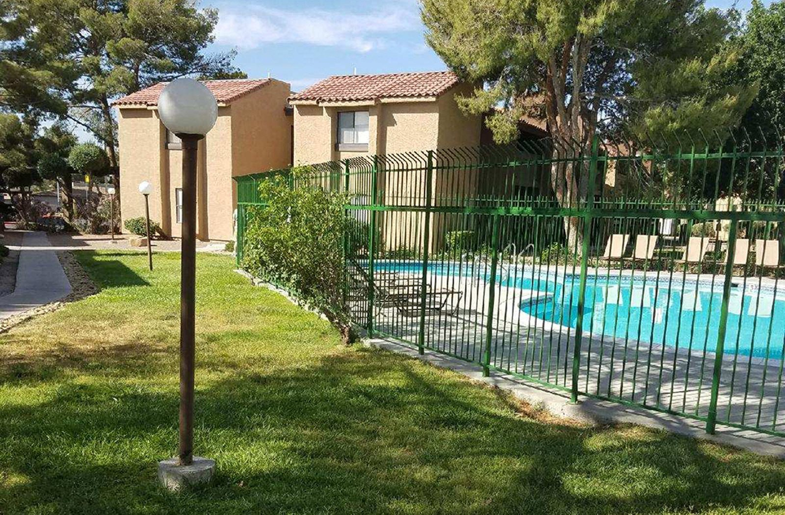 Swimming Pool and walking path near apartment buildings