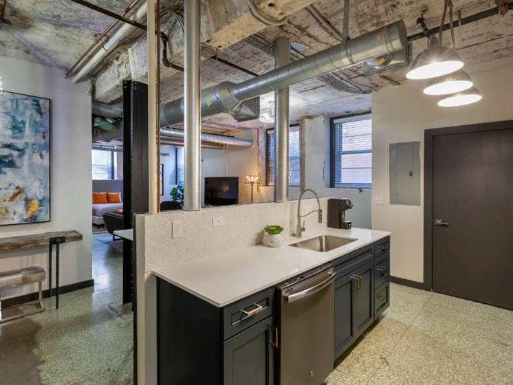 The Indi at Uptown Square Apartments | Industrial Style Loft Kitchen