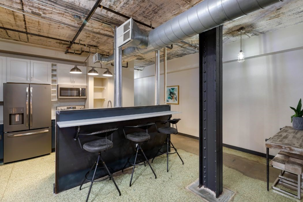 The Indi at Uptown Square Apartments | Industrial Style Loft Kitchen Breakfast Bar