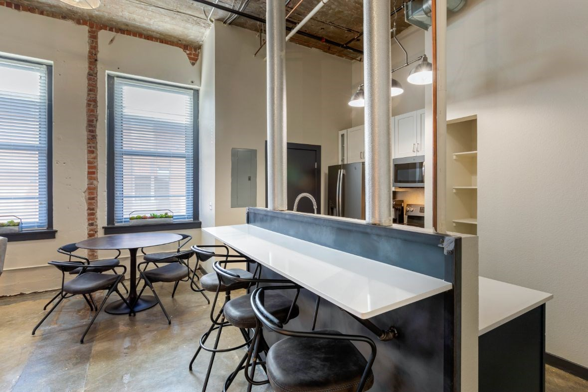 The Indi at Uptown Square Apartments |Industrial Style Kitchen with Breakfast Bar and Dining Room
