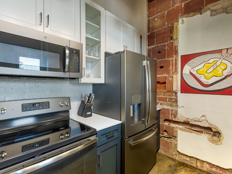 The Indi at Uptown Square Apartments |Fully Equipped Kitchen with Stainless Steel Appliances