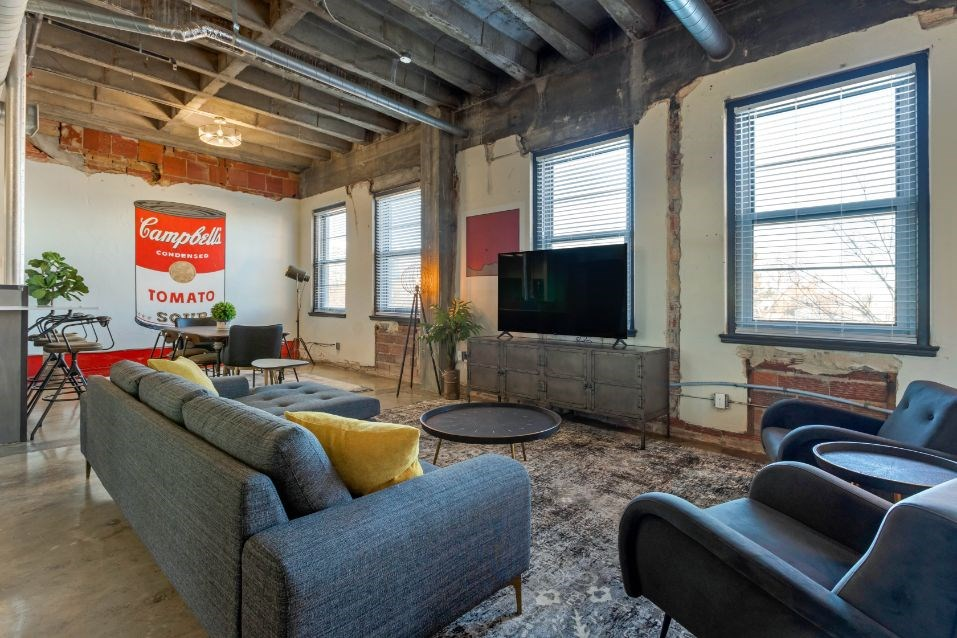 The Indi at Uptown Square Apartments |Open Concept Industrial Style Living Room
