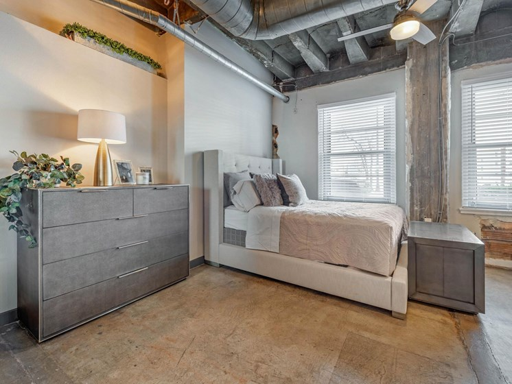 model loft apartment, open concept with exposed concrete and duct work