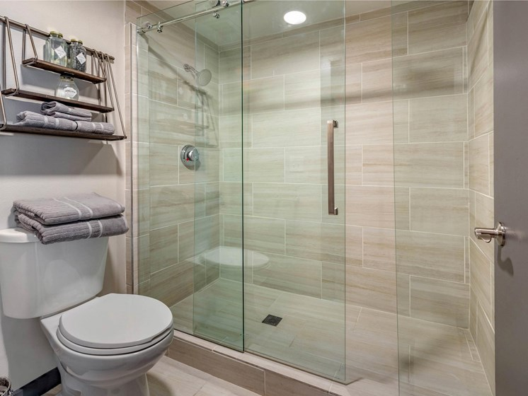 bathroom with glass enclosed shower