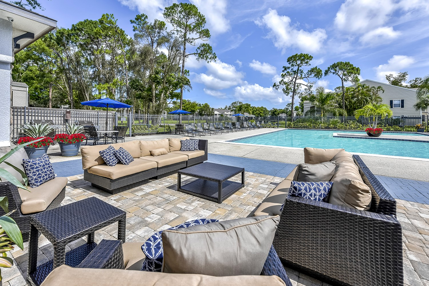 Swimming Pool and Outdoor Lounge at Brantley Pines Apartments in Ft. Myers, FL