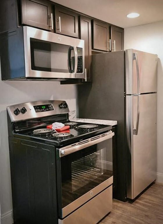 stainless steel appliances in kitchen apartment