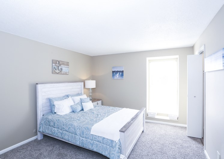Large open bedroom with natural lighting at The Ridge at Chestnut Apartments in South Kansas City, MO
