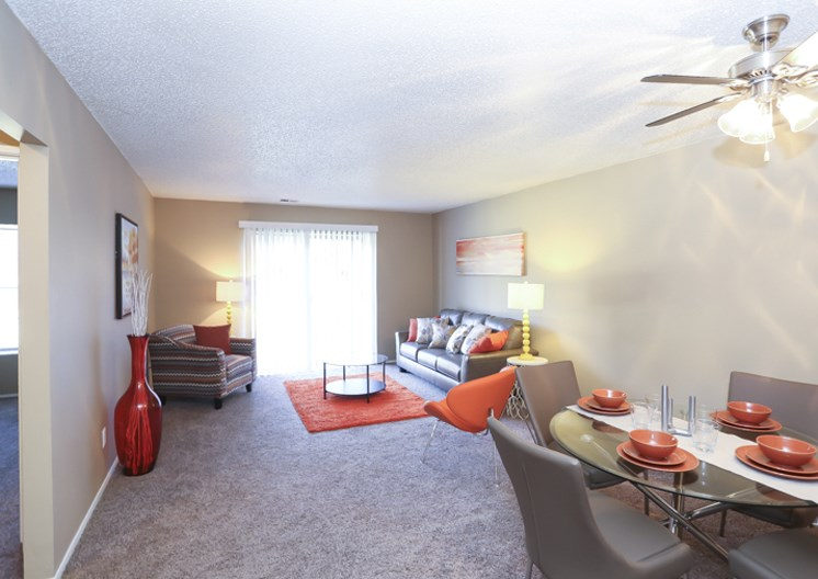Huge living room, dining room, and balcony access at The Ridge at Chestnut Apartments in South Kansas City, MO