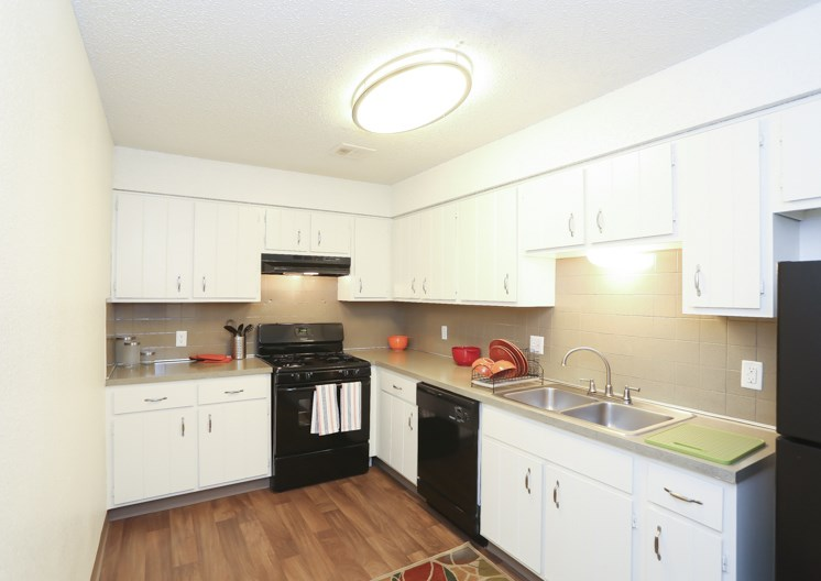 Updated black appliances in kitchen at The Ridge at Chestnut Apartments in South Kansas City, MO
