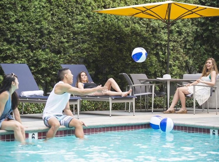 Pool with people playing with beach ball