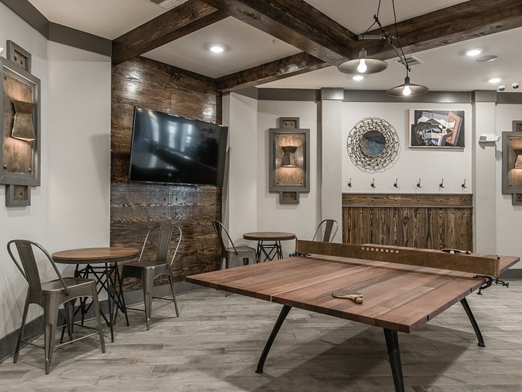 Community Lounge With Ping Pong Table at Vintage at The Avenue Apartments in Murfeesboro, Tennessee