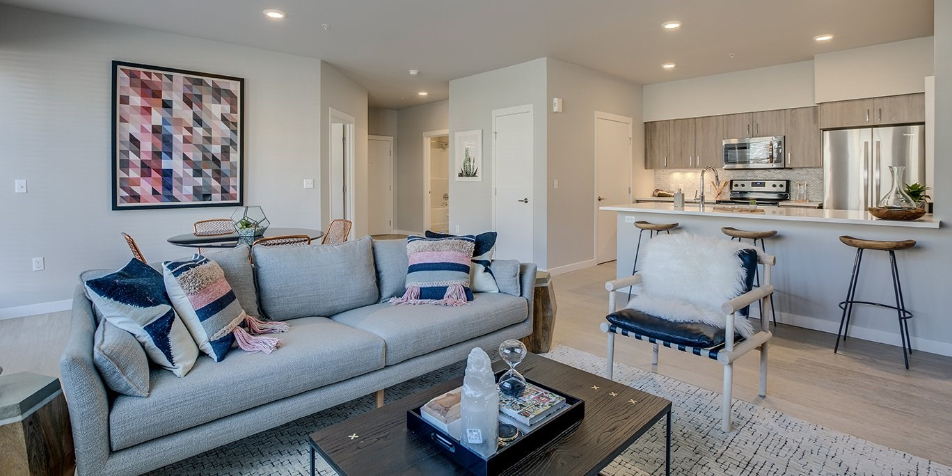 Dog Friendly Apartments in Tigard OR-Sygnii Modern Living Room with Wood-Styled Flooring and an Open Concept Floor Plan