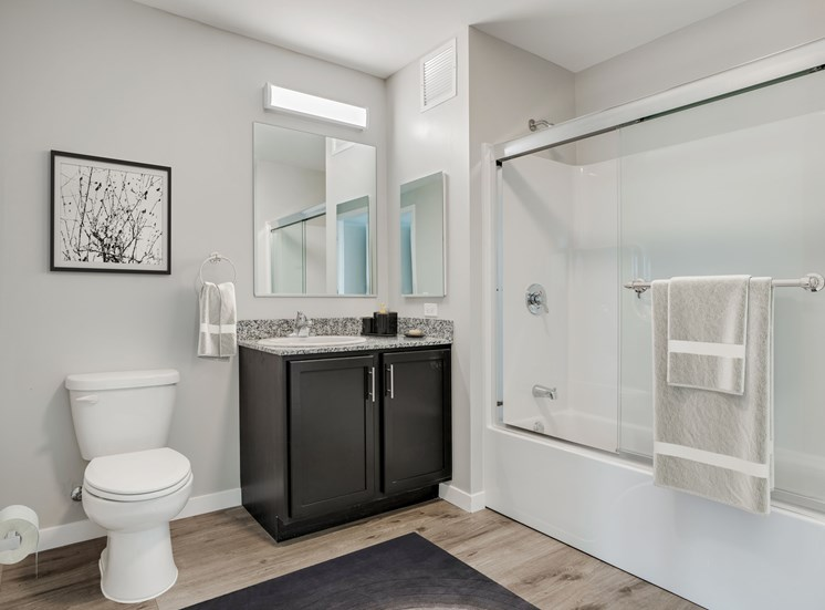 Concord at Sheridan bathroom with granite counter tops, and modern finishes