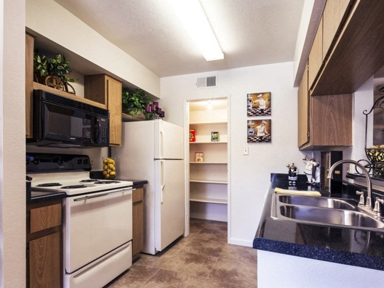 Kitchen (Non-Renovated Apartment) at Presidio North Apartments in Phoenix, AZ