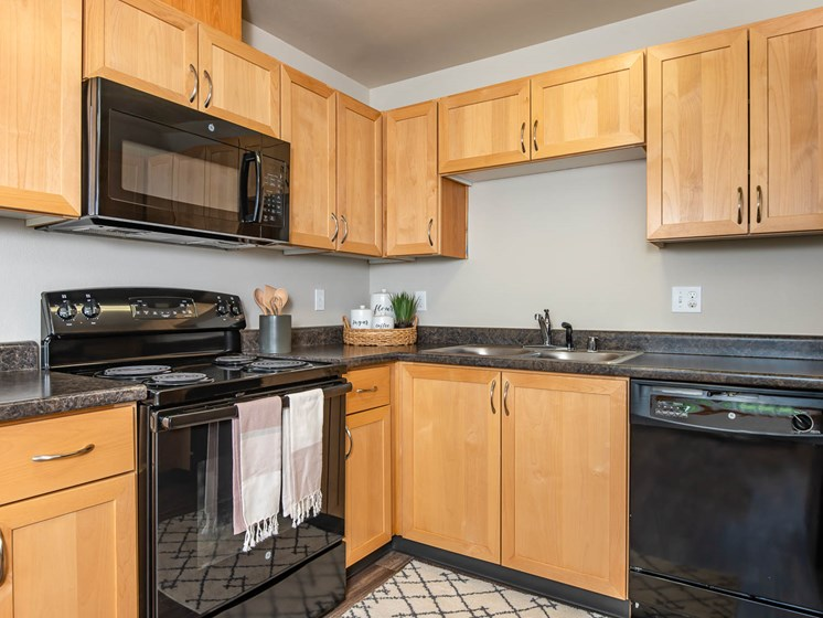 Wood cabinets and black appliance package