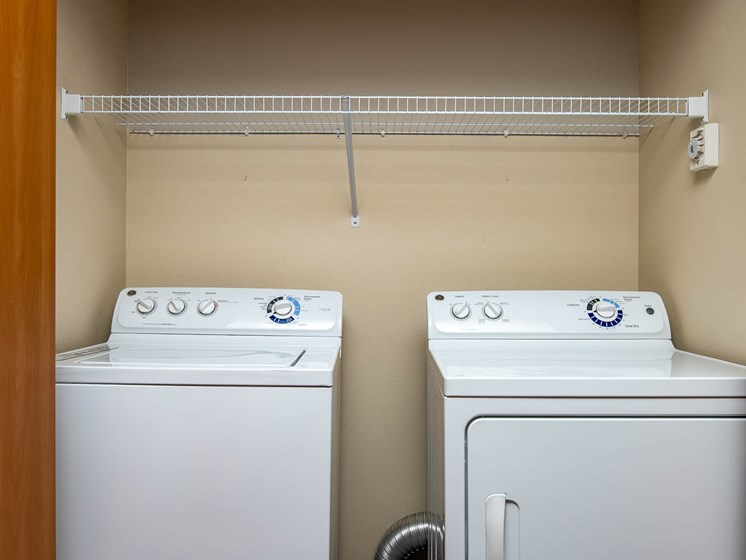 Full size side by side washer and dryer with shelf and storage
